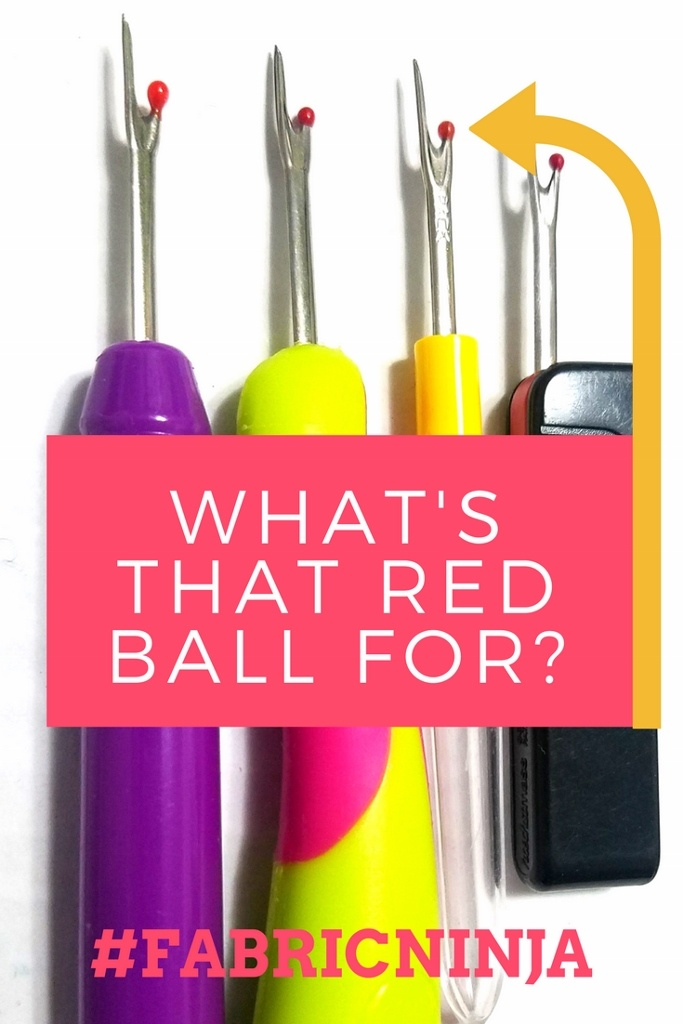 Whats that red ball for? Four different looking colorful seam rippers lined up.